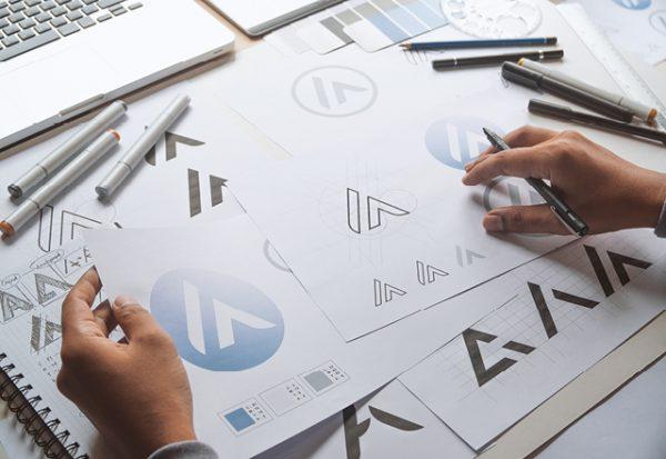 Logo sketches on a desk